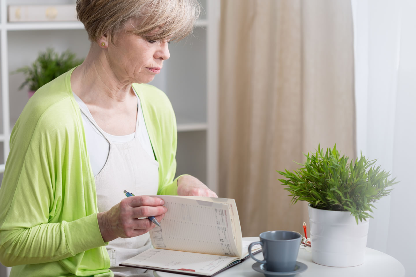 Woman looking at calender, Shutterstock-web