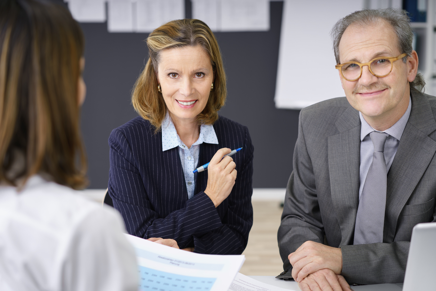 Mature aged man and womn at work shutterstock_369430667